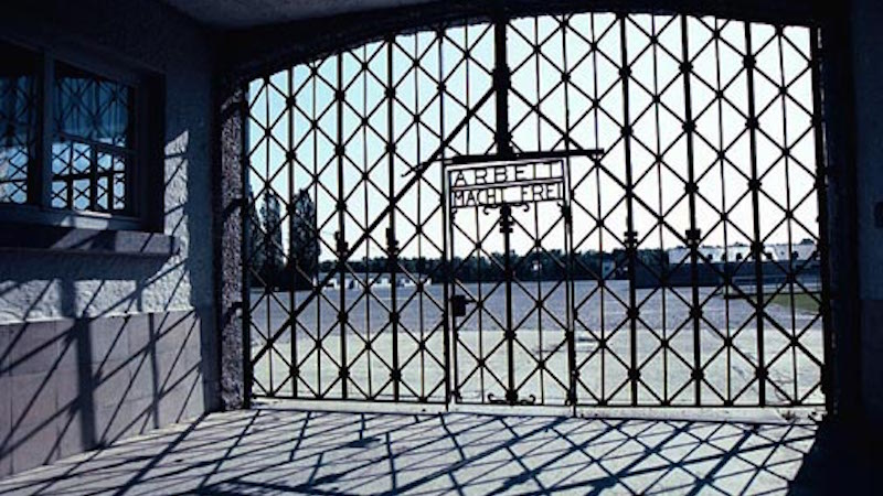 What is ancestral trauma? Gate, Dachau concentration camp, World War II